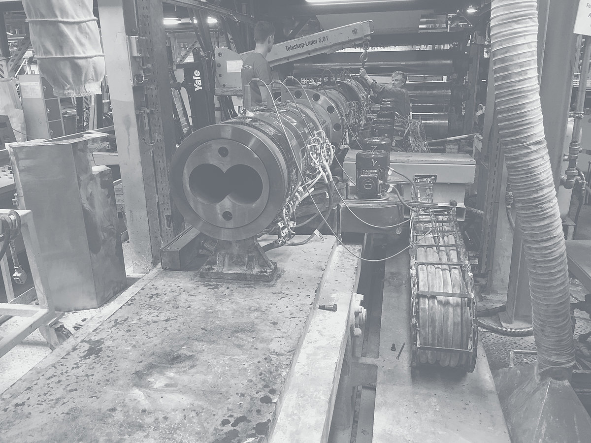 Barrel is built into a machine in a factory building