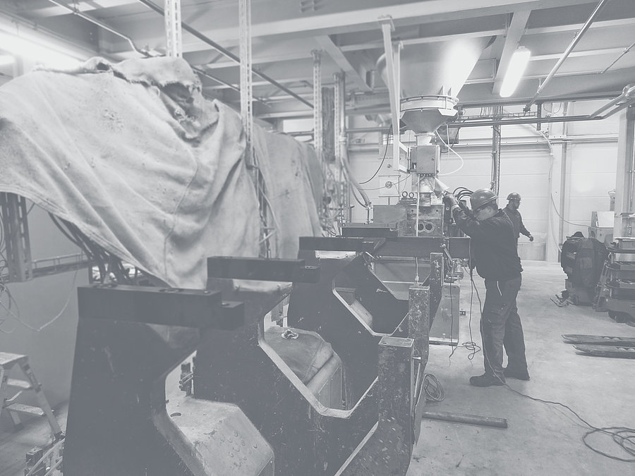 Workshop, where employees operate a machine