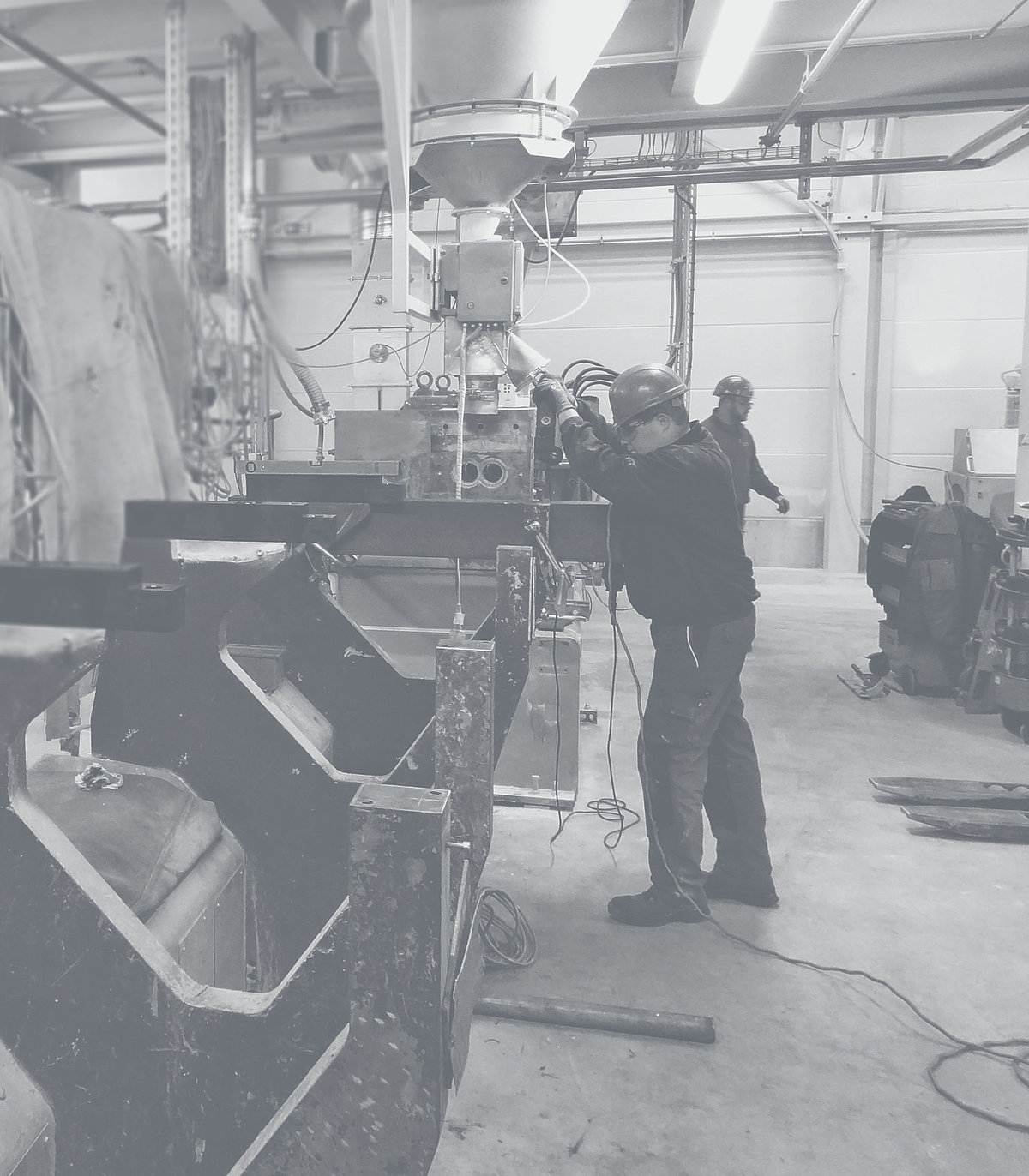 Employee in a workshop operates a machine