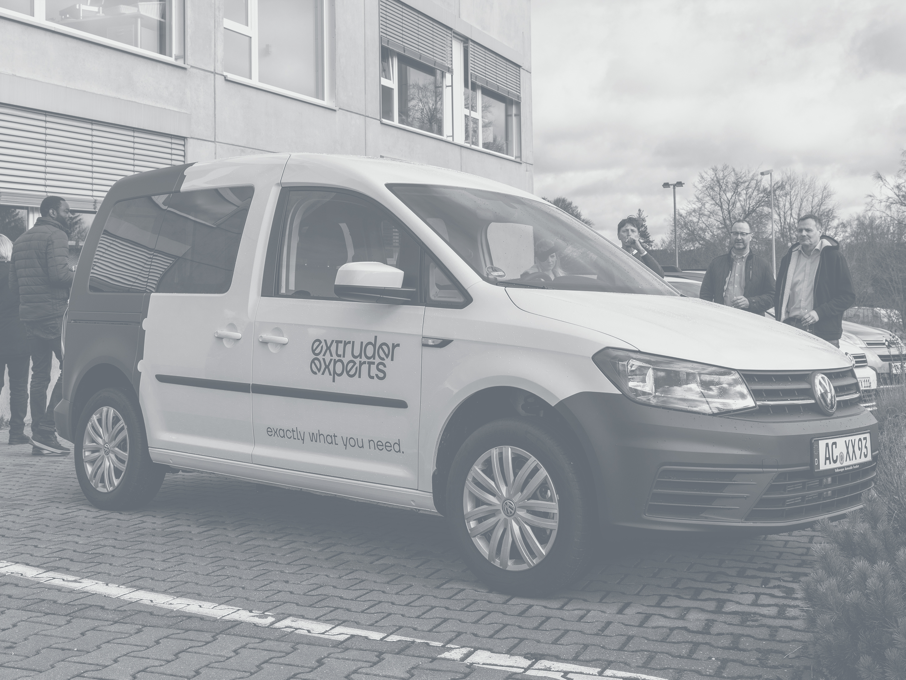 New company vehicle of Extruder Experts in front of the company building